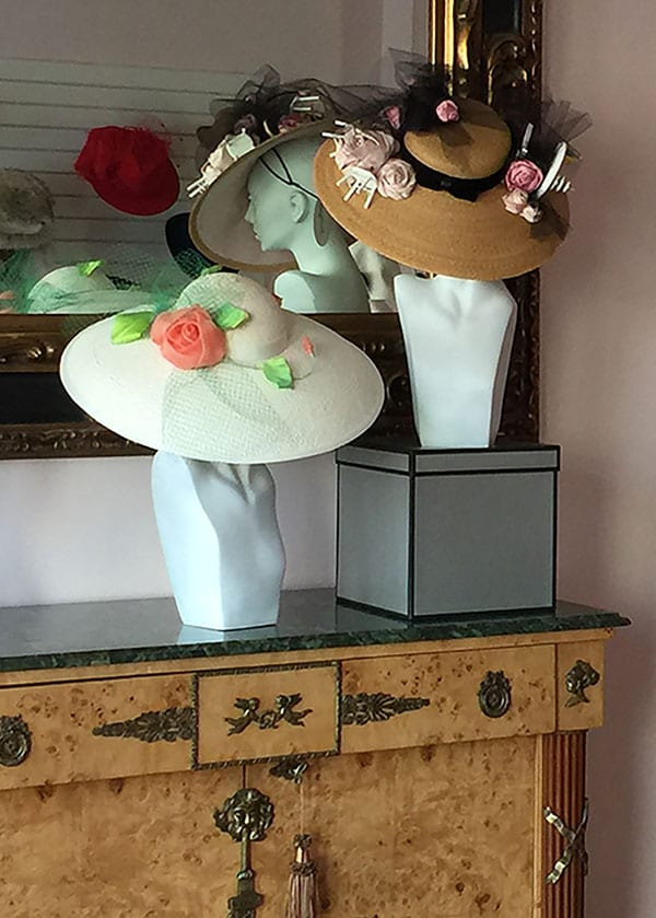 hats displayed on mannequin