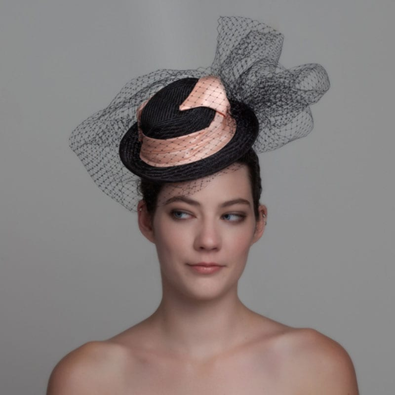 woman wearing fascinator with veiling