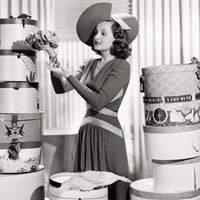 woman with hatboxes